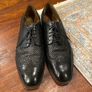 Johnston Murphy men's black leather shoes.